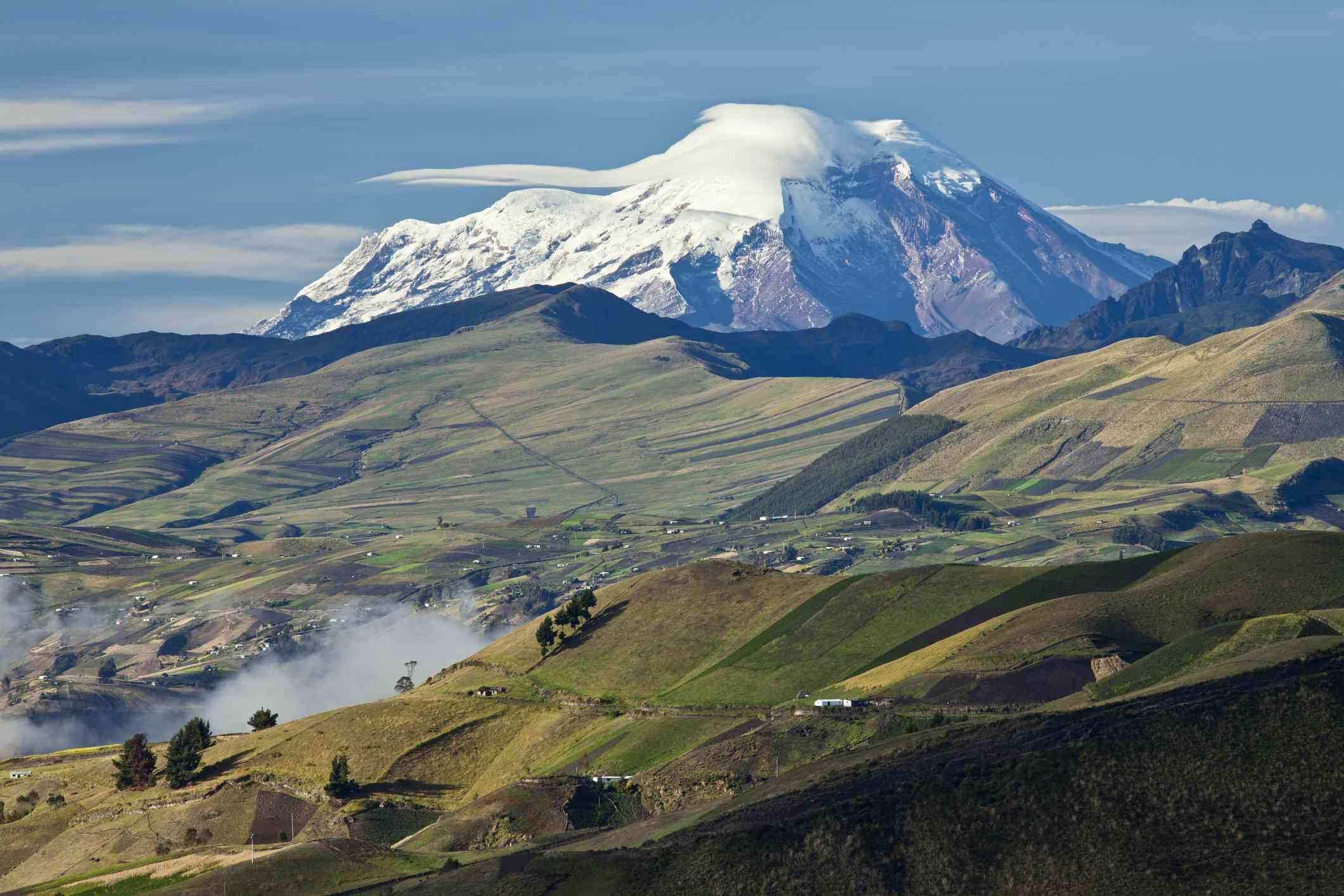 Patchwork of fields in front of Chimborazo Volcano across Valley Latacunga, Ecuador