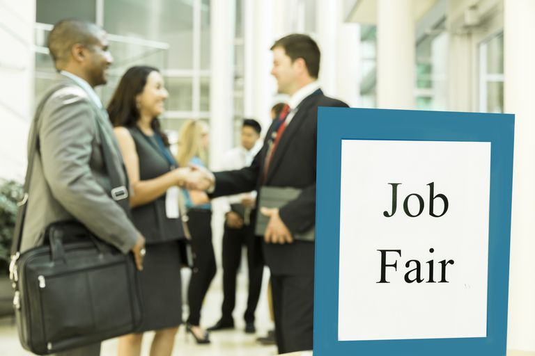 people shaking hands at a Job Fair
