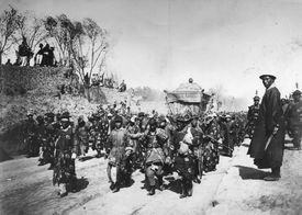 Manchu honor guards carry Empress Cixi's casket at her funeral procession