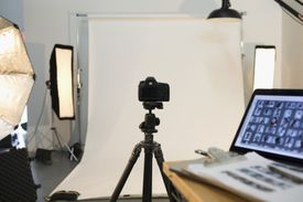 Photography equipment and laptop ready for photo shoot in studio