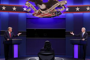 Donald Trump and Joe Biden stand at podiums on opposite ends of a debate stage