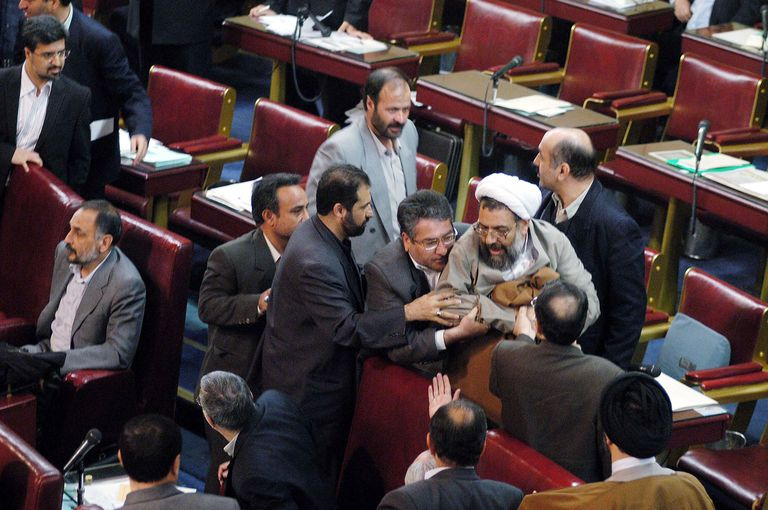 A scuffle breaks out in the Majlis, or Iranian parliament, between a conservative cleric and reformists members, 2003
