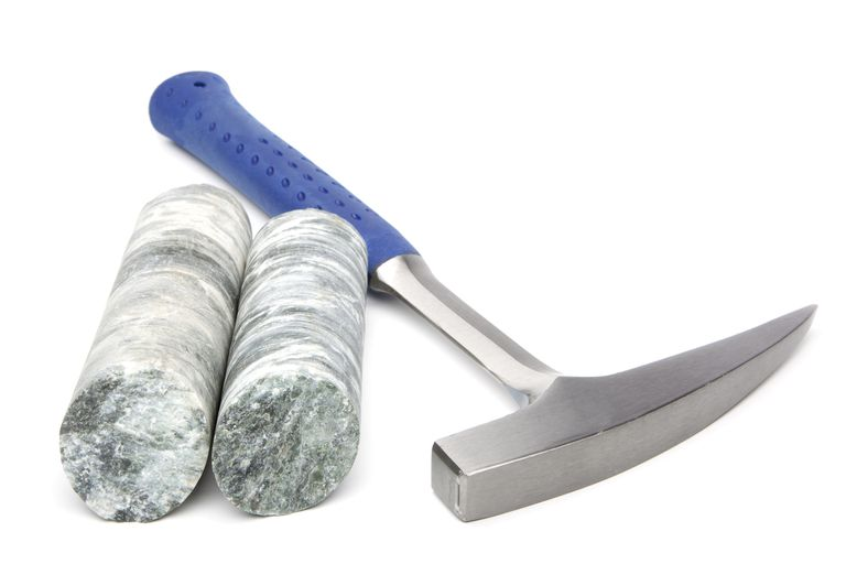 Blue handled geologist hammer with two cylinder rocks