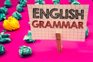 Writing note showing English Grammar. Business photo showcasing Language Knowledge School Education Literature Reading Clothespin hold holding white paper black red letters crumpled papers.