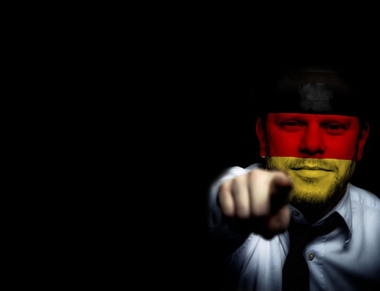 A German Soccer Fanatic. Blue shirt and face in national colors