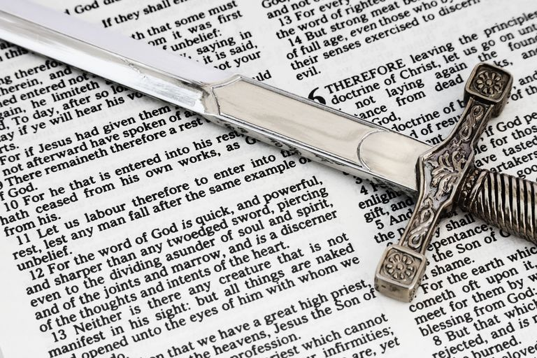 Two Edged Sword on Bible Open to Book of Hebrews