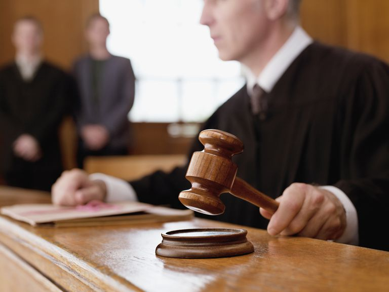 A judge bangs a gavel