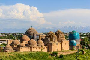 Medieval mausoleums echo the distant mountains' shapes, Samarkand, Uzbekistan.