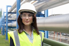 female engineer in safety helmet at a plant