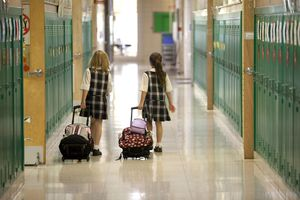 Two young girls in school hallway