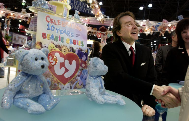 fa36e6757e4 Ty Warner seated at a table with Beanie Babies and celebratory sign