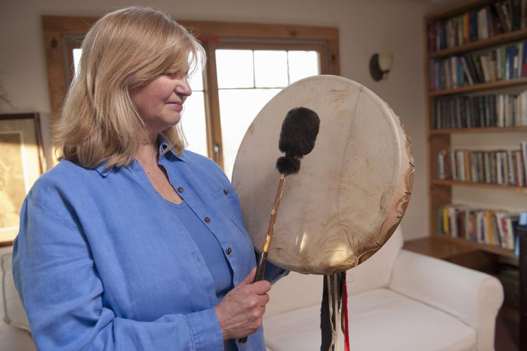 Woman playing drum in alternative therapy