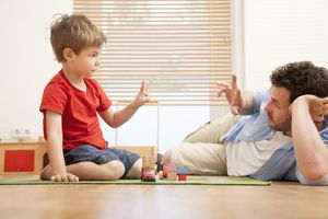 Father practicing counting with son