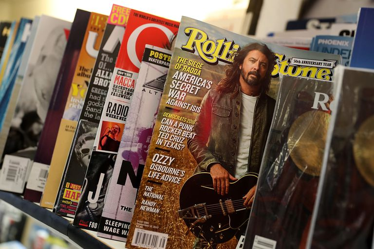 A copy of Rolling Stone magazine is displayed on a shelf at Smoke Signals newsstand