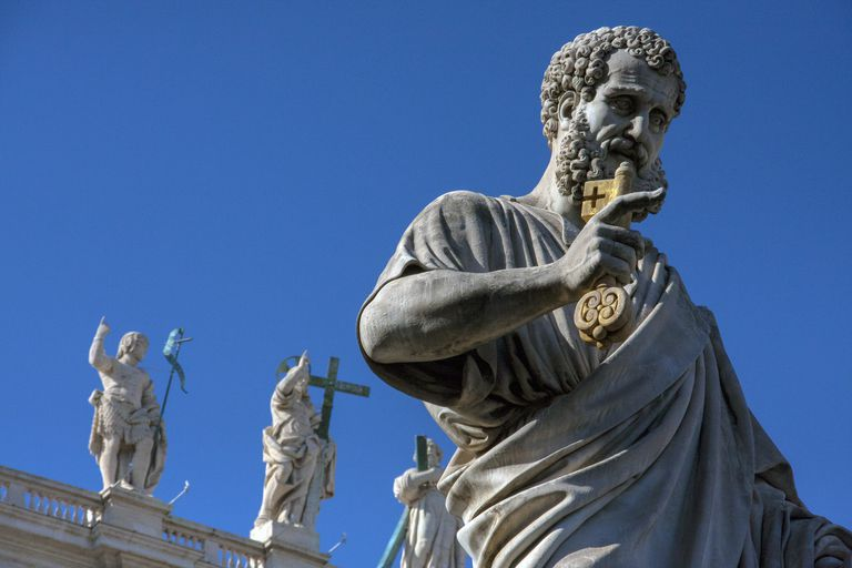 Italy, Rome, Vatican, Statue of Saint Peter against blue sky