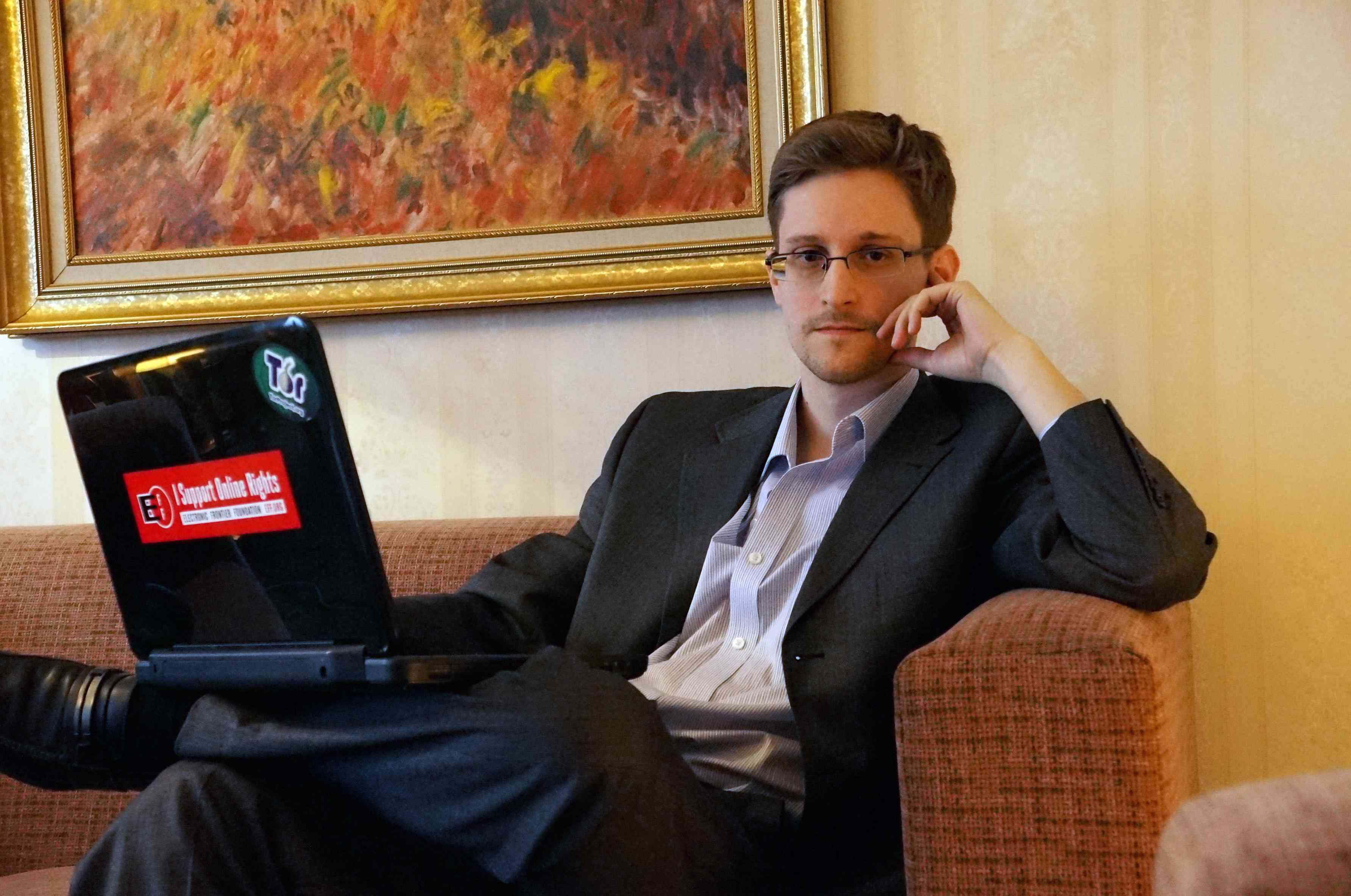Edward Snowden poses for a photo during an interview in an undisclosed location in December 2013 in Moscow, Russia.