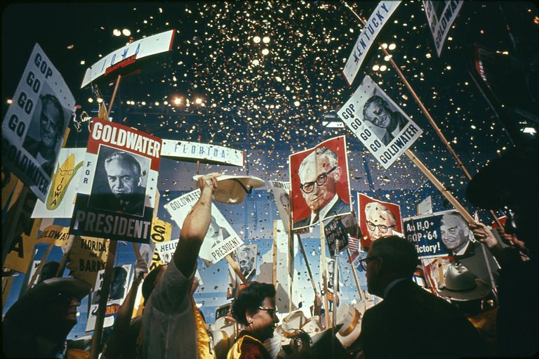 Confetti falling from the ceiling and people holding up Goldwater for President signs