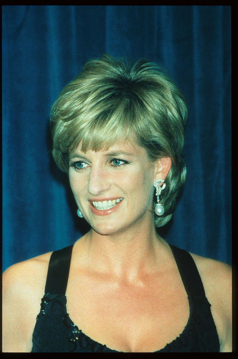 A picture of Lady Diana Spencer smiling at an awards gala.