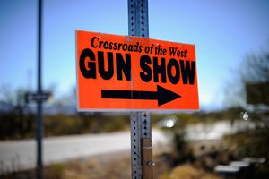 Sign advertising Crossroads of the West gun show