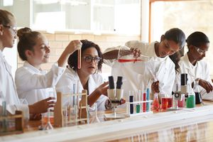 Teacher and students working in science room