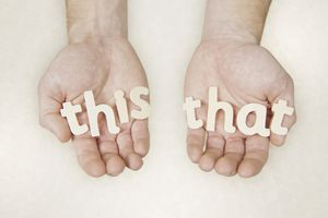 Hands holding block letters that read