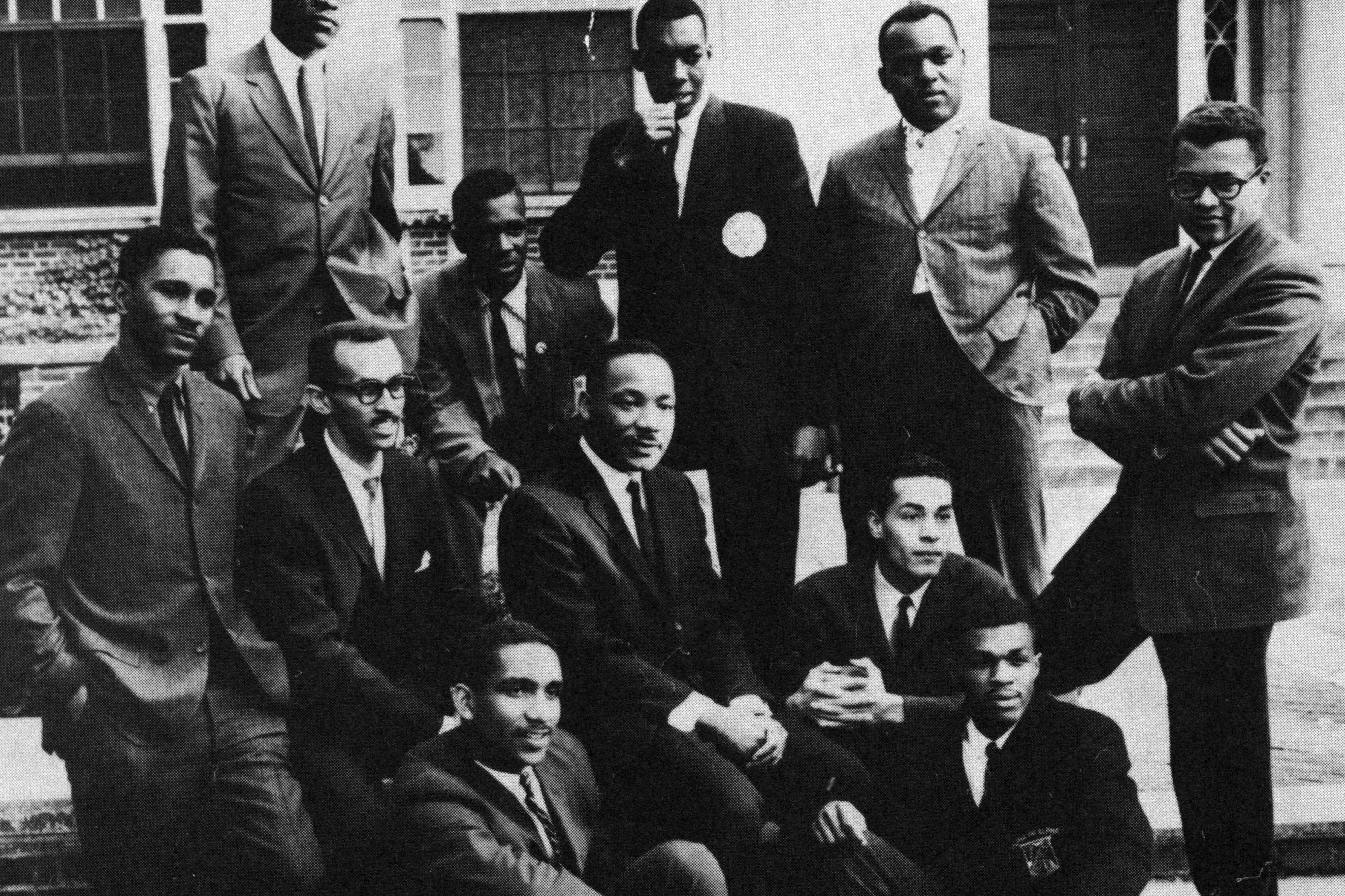 Members of the Student Nonviolent Coordinating Committee posing with Dr. Martin Luther King Jr. on stairs