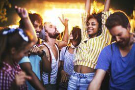 Friends dancing at a concert.