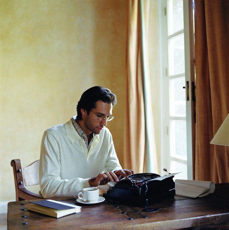 Man typing on manual typewriter