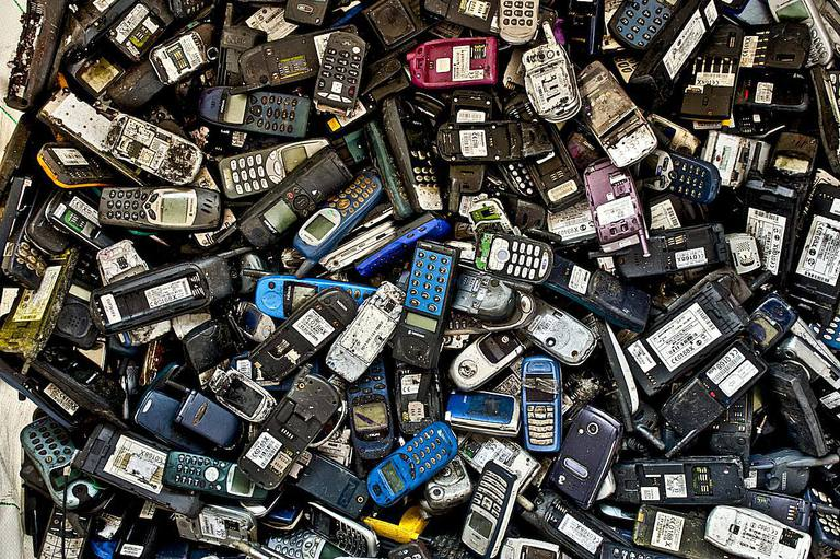 Pile of broken obsolete mobile cell phones