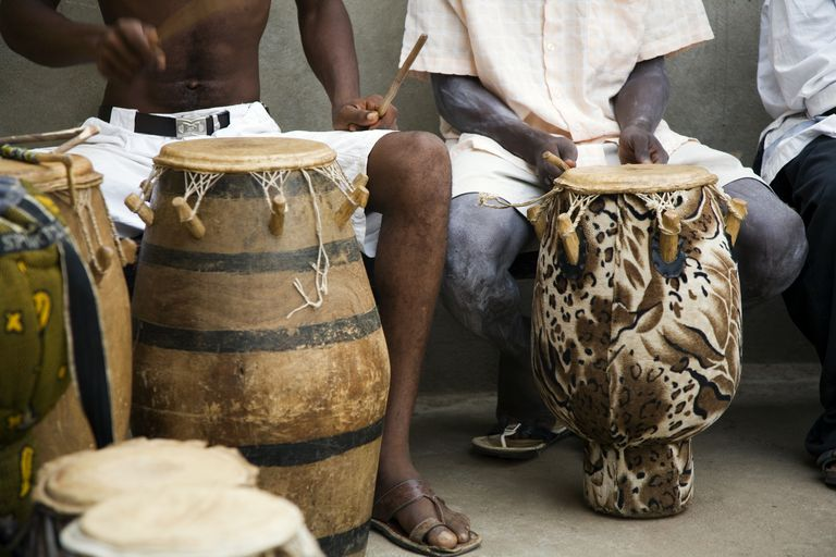 Ghanaian drummers playing drums.