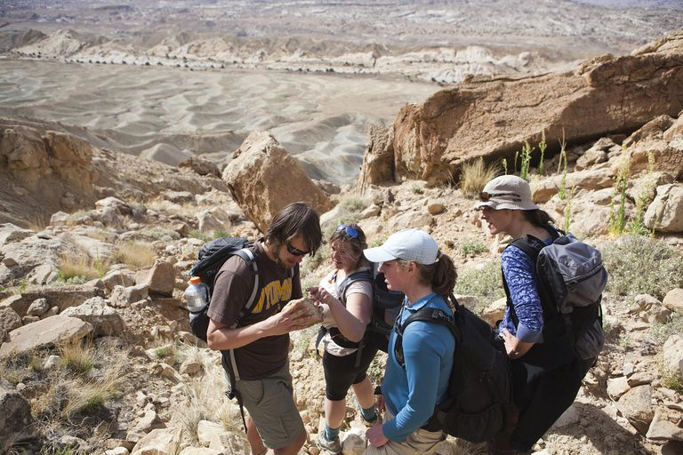 Geology students interpret a rock found below the rim of North Caineville Mesa, Utah.