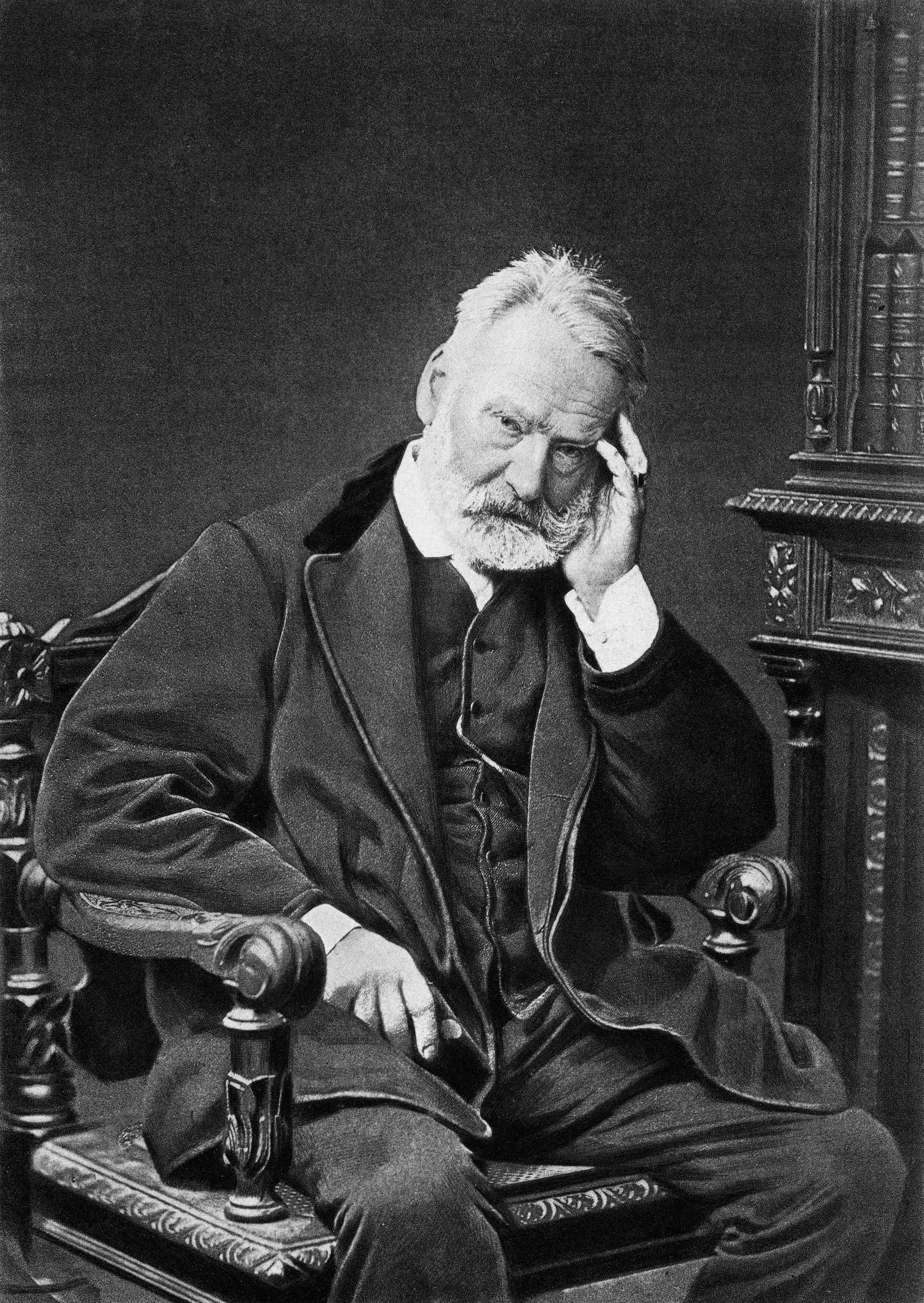 Victor Hugo sitting in a chair