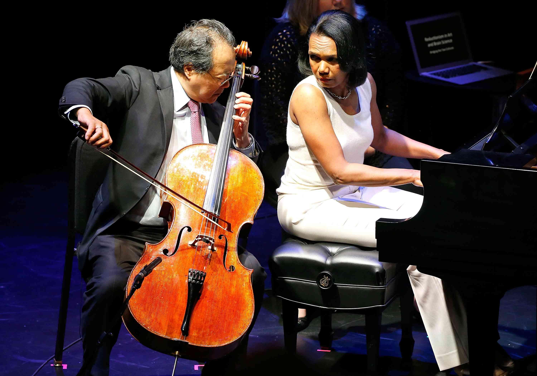 Photograph of former U.S. Secretary of State Condoleeza Rice accompanying cellist Yo-Yo Ma