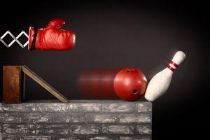 boxing glove hitting bowling ball and pin