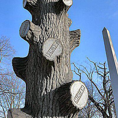 Tree trunk tombstones are an interesting sight in the cemetery