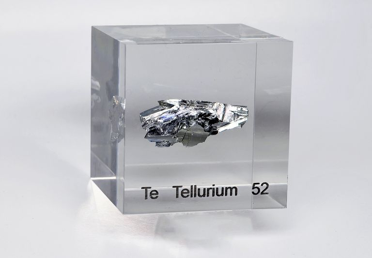 An acrylic cube specially prepared for element collectors containing a sample of pure silicon tellurium