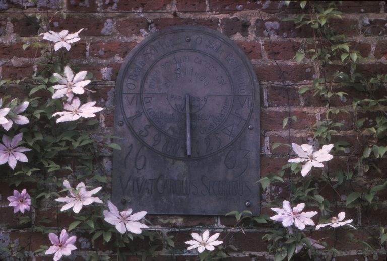 Sundial Dated 1663 in Grounds of Polesdon Lacey, Surrey, 20th century. An Edwardian sundial inscribed 'Vivat Carolus Secundus', ('God is with us') in estate located on the North Downs in Surrey, England.