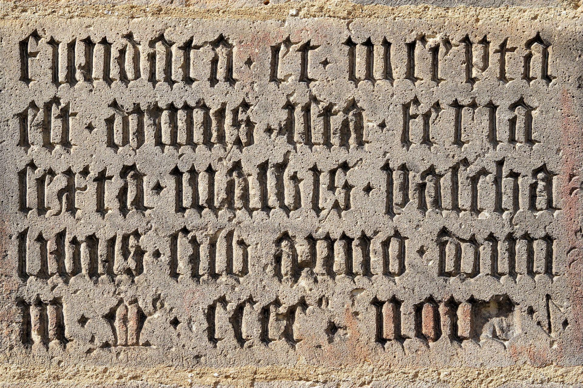 Latin inscribed in stone.