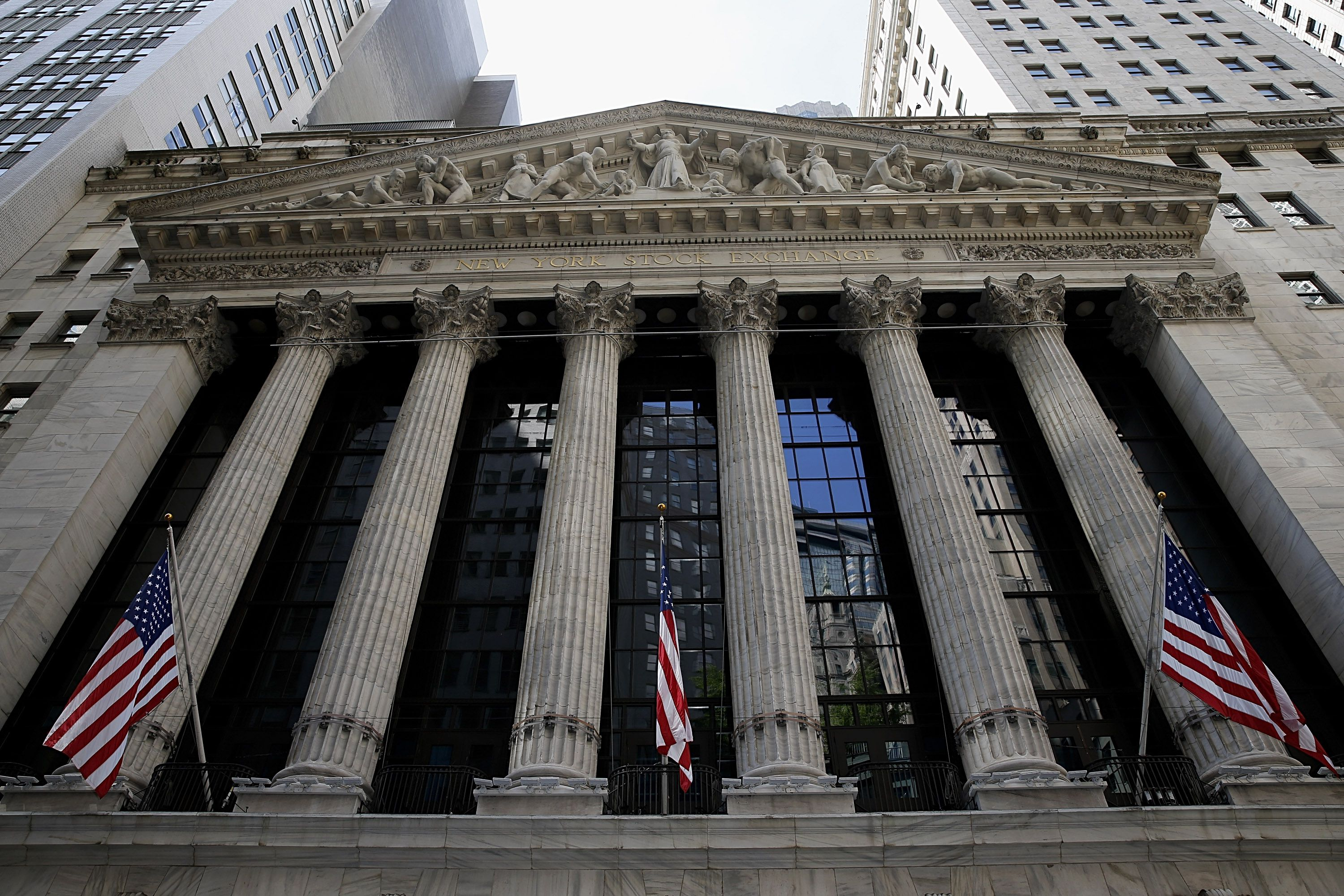 NYSE facade showing 6 fluted Corinthian columns visually create a building of strength and classic beauty.