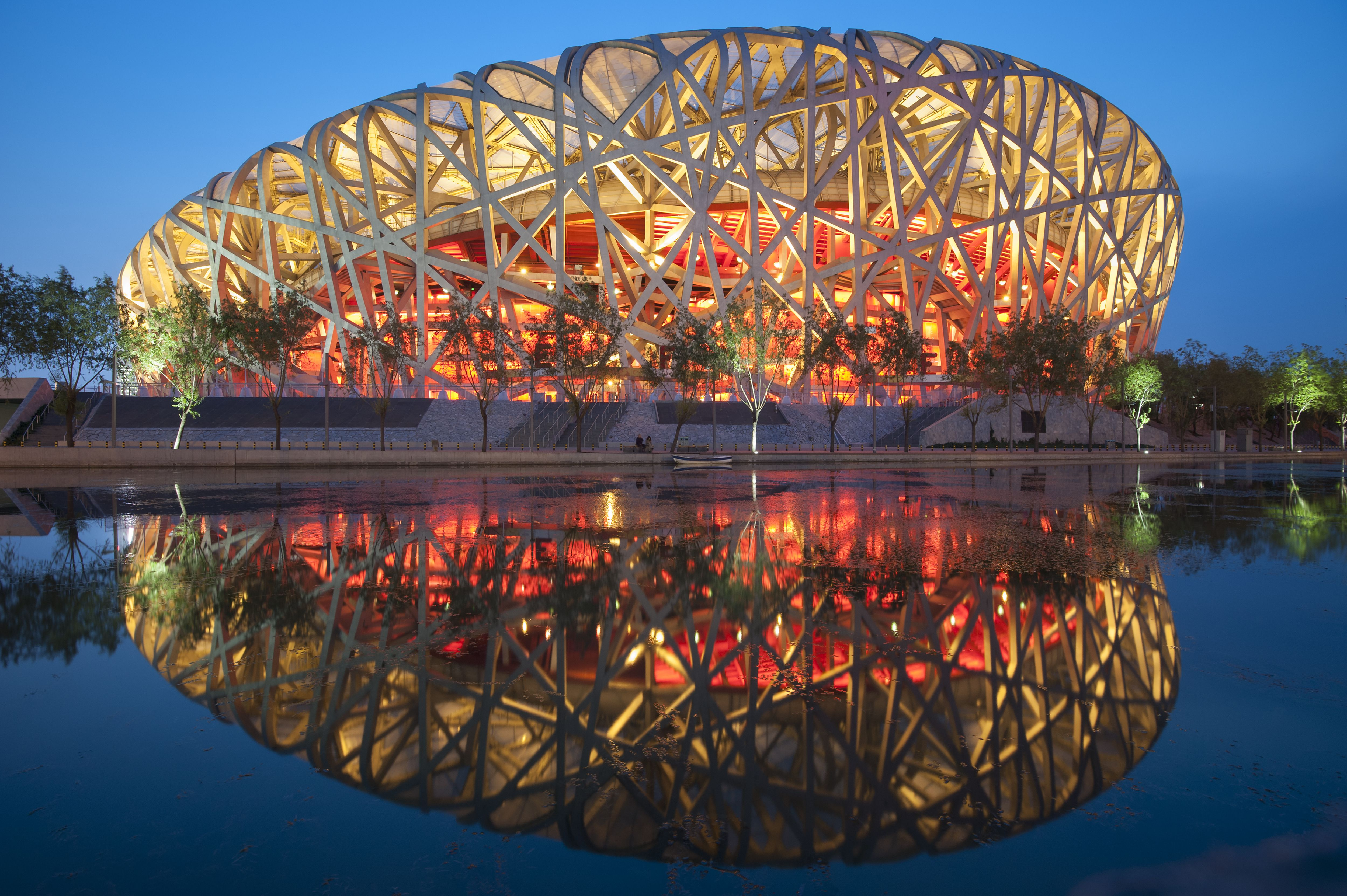 Dusk view of Olympic Stadium, asymmetric with braces obvious and decorative