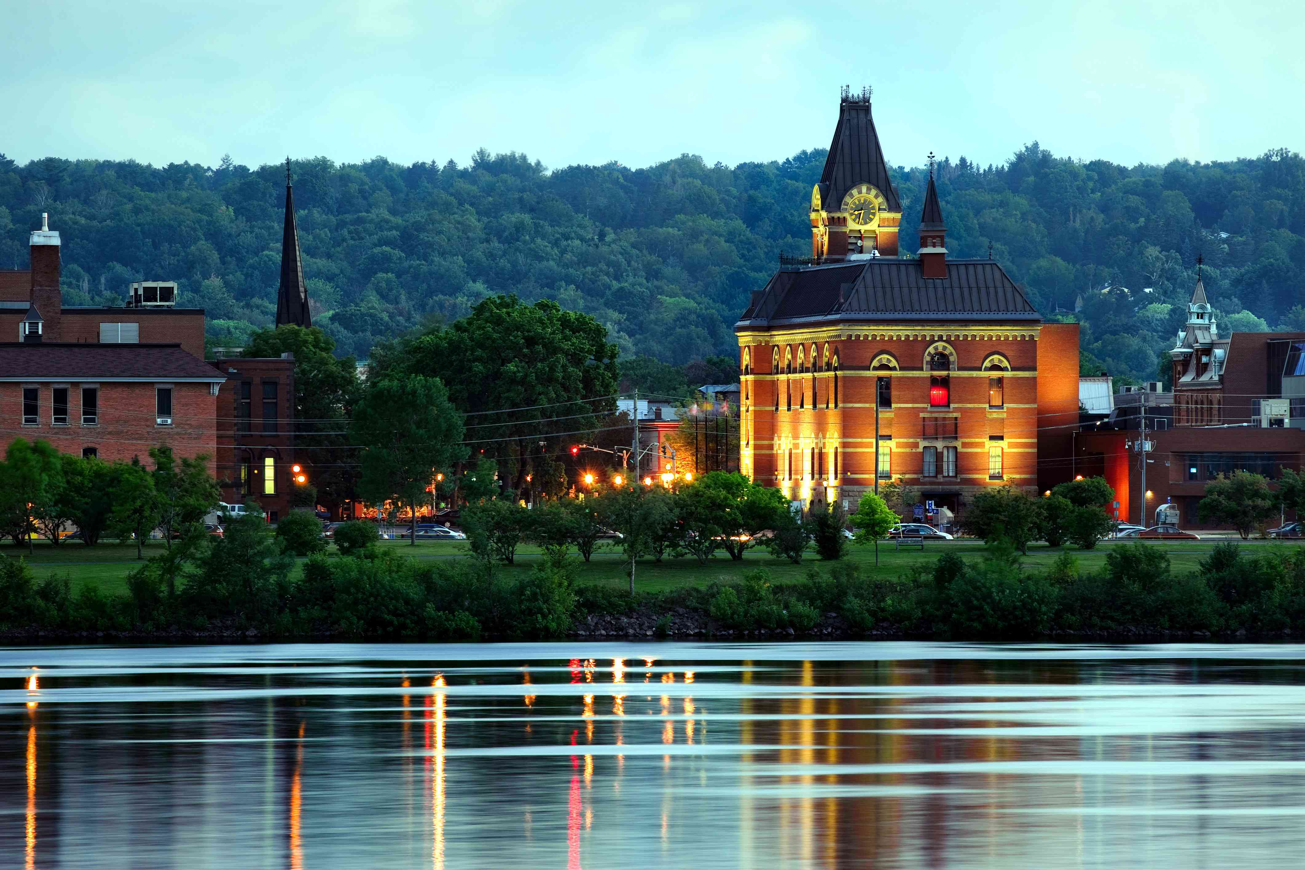 City hall reflected in the Saint John River in downtown Fredericton