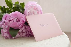 Flowers and a card addressed to