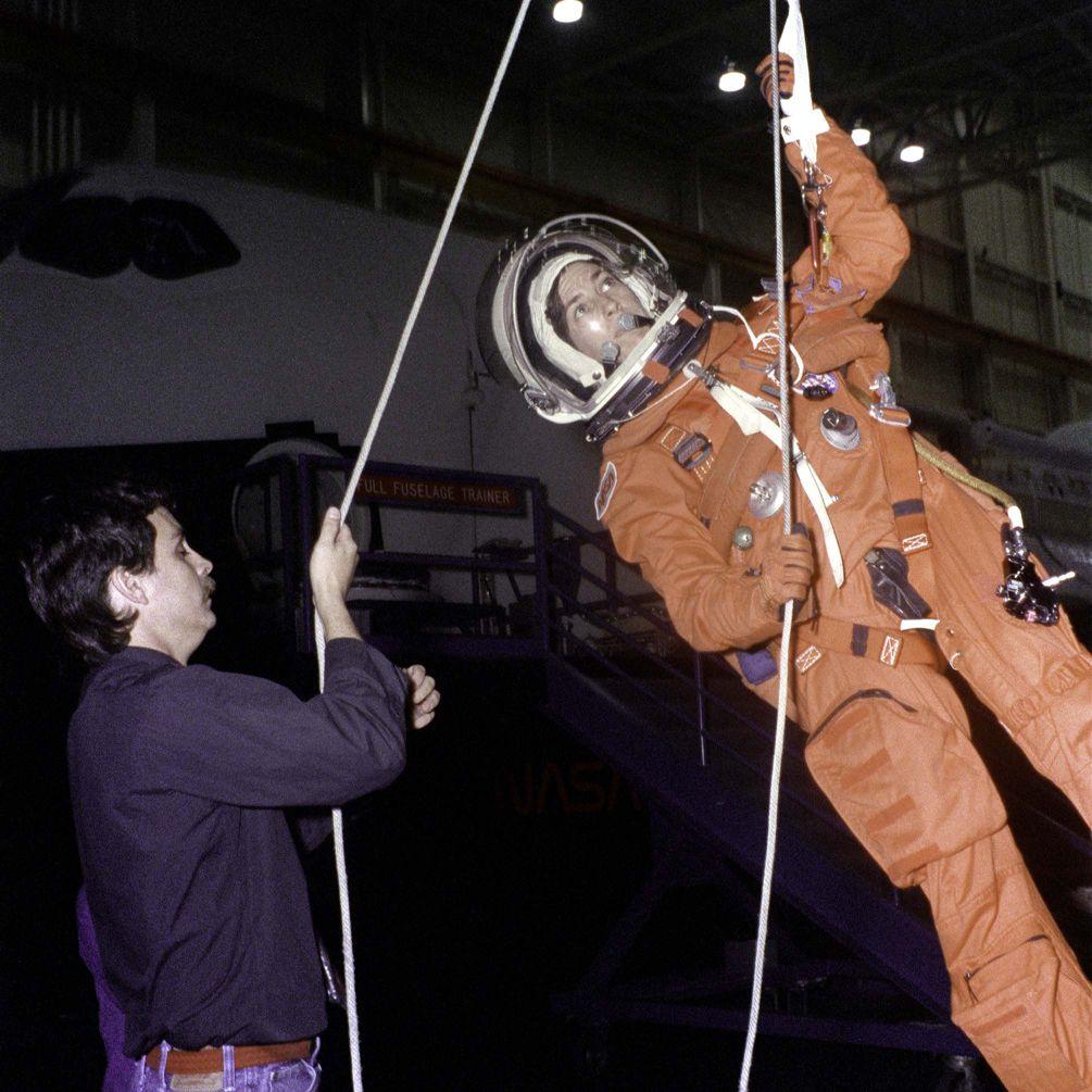 Ellen Ochoa trains for emergency egress from a space shuttle, 1992.