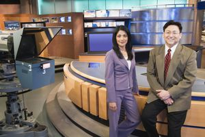 Professional news anchors onset before a broadcast