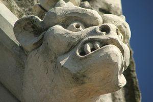 A gargoyle on a cornice