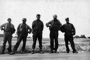 Five black convicts work on chain gang