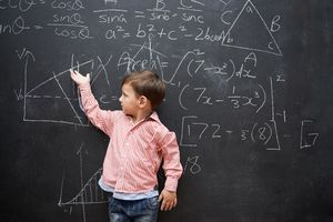 Child in front of a chalkboard