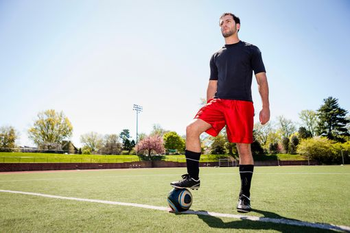 Soccer player preparing for free kick