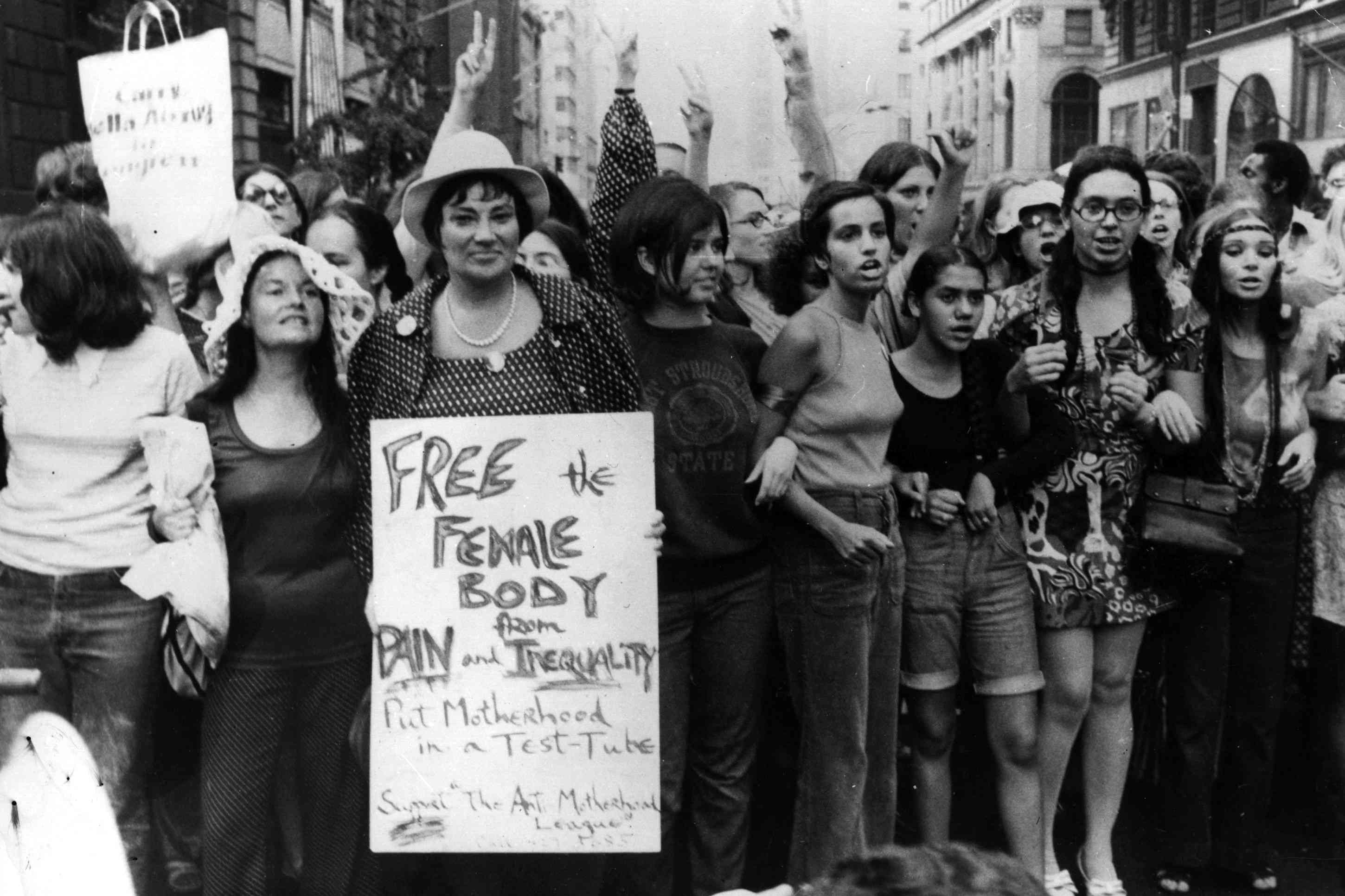 Bella Abzug features prominently among a crowd of women during her run for Congress as a chief organisers of the Women's Liberation Day parade in New York, on the 50th anniversary of women's suffrage in the U.S.