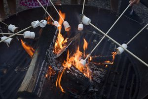 Toasting marshmallows over a BBQ